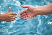 ist2_9494420-reaching-hand